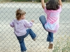 girls-climbing-fence-2